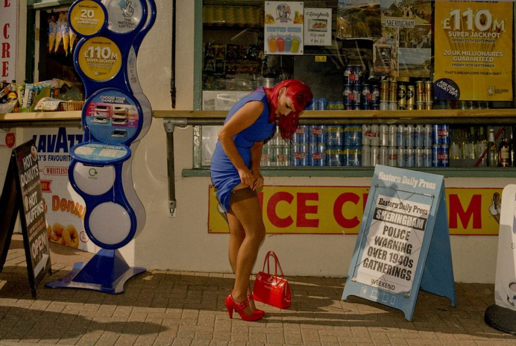 Si Barber - Model and WW2 re-enactment enthusiast, Bettie Hayward, adjusts her stocking in Sheringham High St on 19th September 2020, which would have normally been the town's 1940's day, but was cancelled due to the Covid 19 pandemic - Photograph - 40 x 30 cm - £40