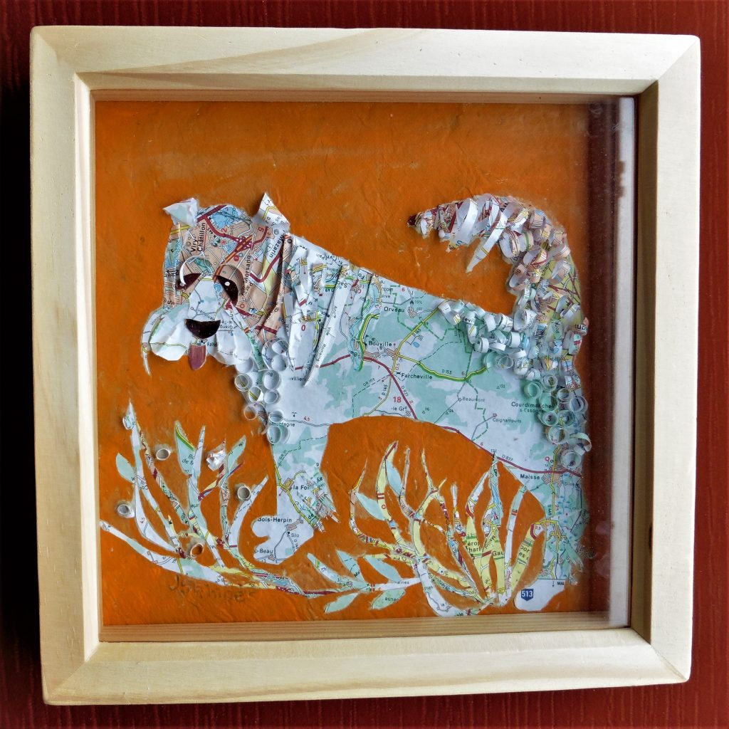 June Skinner - Paper Dog - Mixed media, an old map and acrylic - 24 x 24 cm - £50